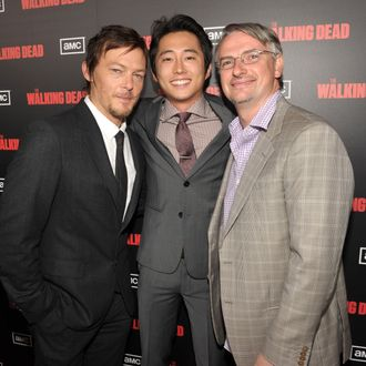 Norman Reedus, Steven Yeun, and Glen Mazzara attend the premiere of AMC's