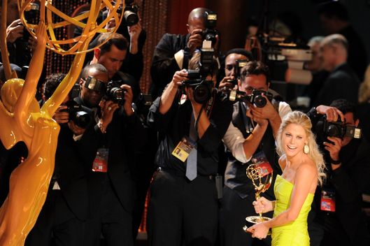 "LOS ANGELES, CA - SEPTEMBER 23:  Actress Julie Bowen accepts Outstanding Supporting Actress in a Comedy Series award for ""Modern Family"" onstage during the 64th Annual Primetime Emmy Awards at Nokia Theatre L.A. Live on September 23, 2012 in Los Angeles, California.  (Photo by Kevin Winter/Getty Images)"