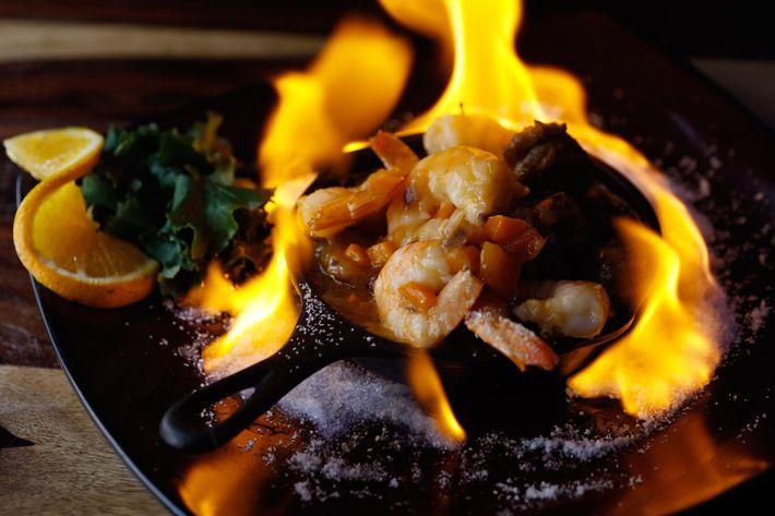 Mad Shrimp: sautéed shrimp with chorizo on a bed of sweet plantains.