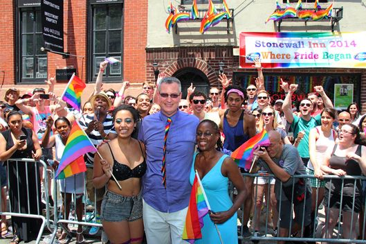 New York, United States. 29th June 2014 -- New York City Mayor Bill DeBlasio with wife and daughter in front of the historic Stonewall Inn as they join the annual Pride Parade. -- The first March was held in 1970 and has since become an annual civil rights demonstration. Over the years its purpose has broadened to include recognition of the fight against AIDS and to remember those we have lost to illness, violence and neglect.