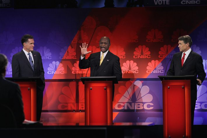 ROCHESTER, MI - NOVEMBER 09:  Republican presidential candidates (L to R) former Massachusetts Governor Mitt Romney, businessman Herman Cain, and Texas Governor Rick Perry participate in a debate hosted by CNBC and the Michigan Republican Party at Oakland University on November 9, 2011 in Rochester, Michigan. The debate is the first meeting of the eight GOP presidential hopefuls since allegations of sexual impropriety have surfaced against front-runner Herman Cain.  (Photo by Scott Olson/Getty Images)