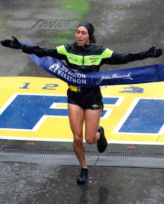 Desiree Linden crossing the finish line.