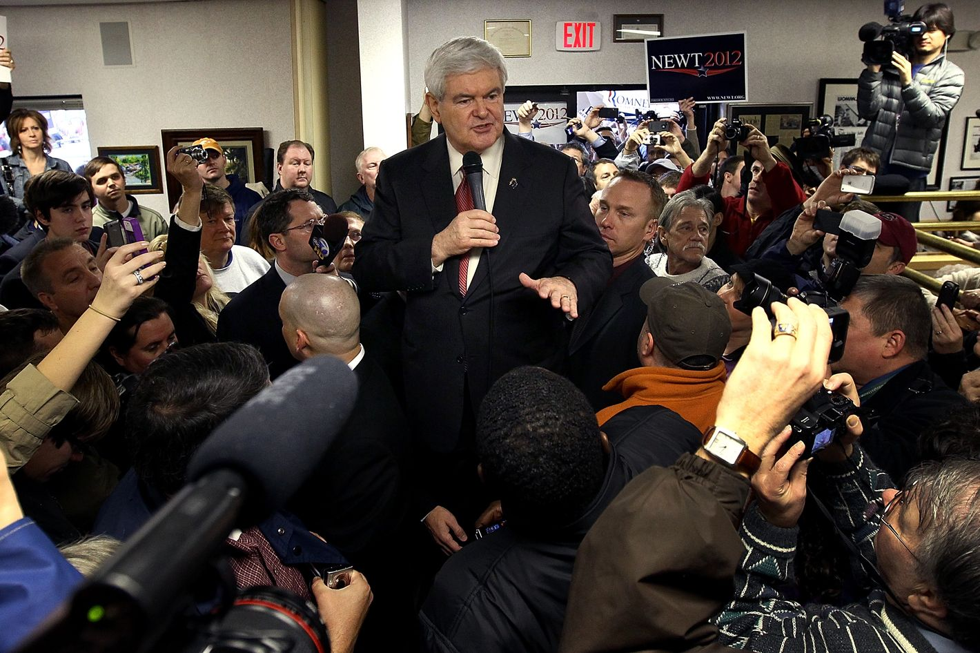 GREENVILLE, SC - JANUARY 21:  Republican presidential candidate, former Speaker of the House Newt Gingrich speaks to a packed house while standing on an ice cooler at Tommy's Country Ham House January 21, 2012 in Greenville, South Carolina. Republican presidential candidate, former Massachusetts Gov. Mitt Romney also campaigned at Tommy's Country Ham House just before Gingrich. South Carolina holds its pivotal presidential primary today.  (Photo by Win McNamee/Getty Images)