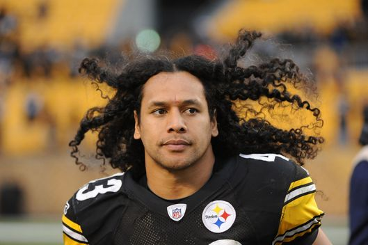 The hair of safety Troy Polamalu #43 of the Pittsburgh Steelers bounces in the air as he jogs off the field following a game against the Cincinnati Bengals at Heinz Field on December 4, 2011 in Pittsburgh, Pennsylvania.