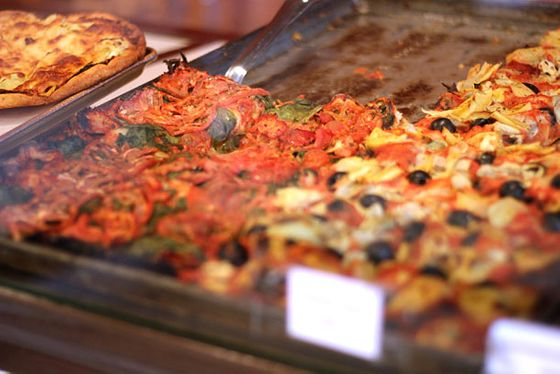 "<b>Sicilian</b>    <a href=""http://www.yelp.com/biz/d-amatos-bakery-chicago"">D'Amato's Bakery</a>    <i>Chicago</i>  Not only does this Windy City bakery make its own bread, but the original Grand Avenue location also employs the city's oldest coal-burning oven to hatch its sharply sauced, melted-mozzarella-topped Sicilians, piping hot from the oven in full sheets and served in room-temperature slices or by the preordered pan."