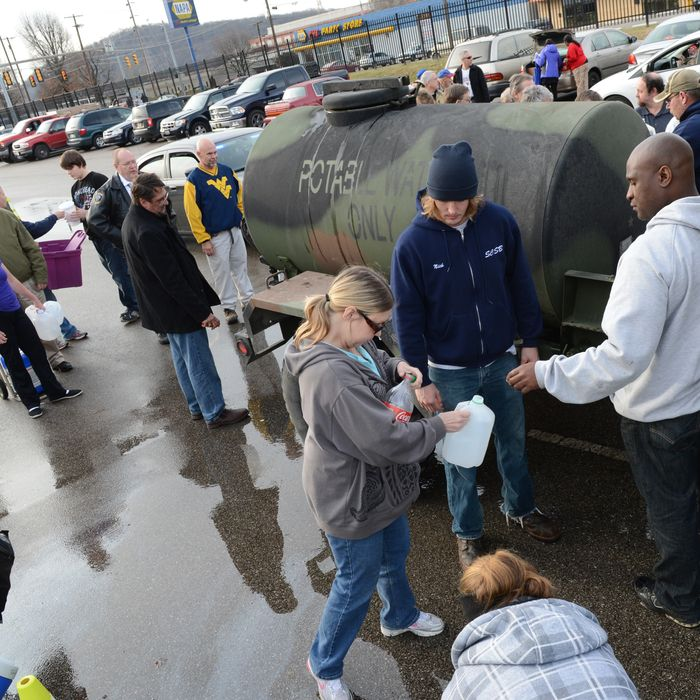SOUTH CHARLESTON, WV - JANUARY 10: West Virginia American Water customers line up for water at the Gestamp Plant after waiting hours for a water truck, only to have it empited in about 20 minutes on January 10, 2014 in South Charleston, West Virginia. West Virginia American Water determined Thursday MCHM chemical had
