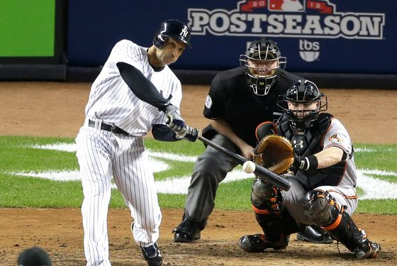 New York Yankees' Raul Ibanez hits a solo home run to tie the game in the ninth inning in Game 3 of the American League division baseball series against the Baltimore Orioles on Wednesday, Oct. 10, 2012, in New York. The Orioles catcher is Matt Wieters and the umpire is Brian Gorman.