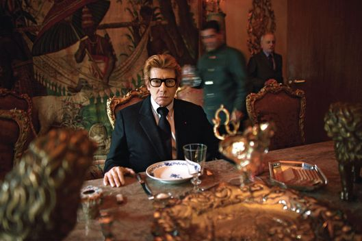 Yves Saint Laurent having lunch at home in Paris, the day before his last haute couture show in Georges Pompidou Centre, Jan. 21, 2002. The show marked the retirement of Yves Saint Laurent after 40 years of designing haute couture for the rich and famous.Photo by: Alexandra Boulat / VII