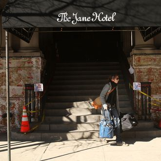 A guest walks out of the Jane Hotel, a new hotel built around the concept of budget conscious travel with style on March 23, 2009 in New York City. Opening in stages until the end of the summer, the Jane Hotel will offer approximately 150 small rooms-7 feet wide by eight feet long- at less than $100 per night and slightly larger