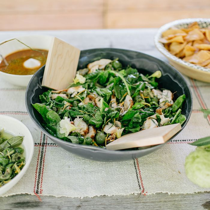Salad with roast chicken, arugula, and citrus-marinated olives.