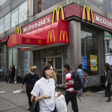NEW YORK, NY - JUNE 09:  People walk past a McDonald's restaurant on June 9, 2014 in New York City. McDonald's domestic sales rose slightly in May, but remain weak overall.  (Photo by Andrew Burton/Getty Images)