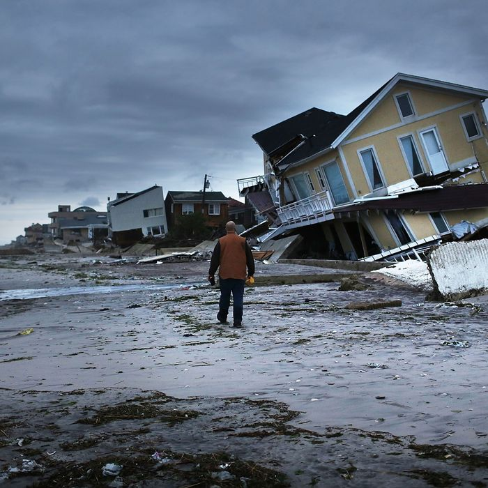 NEW YORK, NY - OCTOBER 31: Damage is viewed in the Rockaway neighborhood where the historic boardwalk was washed away during Hurricane Sandy on October 31, 2012 in the Queens borough of New York City. With the death toll currently at 55 and millions of homes and businesses without power, the US east coast is attempting to recover from the affects of floods, fires and power outages brought on by Hurricane Sandy. JFK airport in New York and Newark airport in New Jersey expect to resume flights on Wednesday morning and the New York Stock Exchange commenced trading after being closed for two days. (Photo by Spencer Platt/Getty Images)