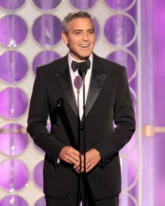 69th ANNUAL GOLDEN GLOBE AWARDS -- Pictured: George Clooney on stage during the 69th Annual Golden Globe Awards held at the Beverly Hilton Hotel on January 15, 2012 - (NBC Photo by: Paul Drinkwater/NBC/NBCU Photo Bank via AP Images)