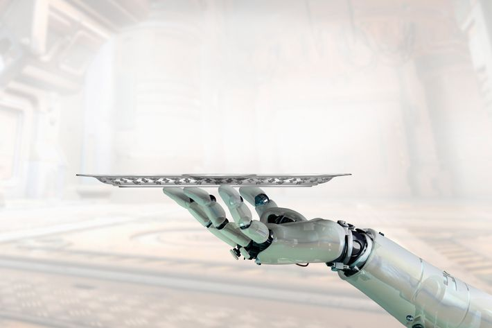 Robot Arm Holding Tray --- Image by ? William Whitehurst/Corbis