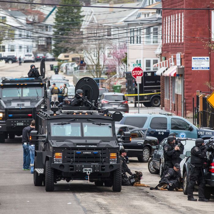 WATERTOWN, MA - APRIL 19: SWAT teams moved into position at the intersection of Nichols Avenue and Melendy Avenue in Watertown while searching for one of the two marathon bombing suspects. (Photo by Aram Boghosian for The Boston Globe via Getty Images)
