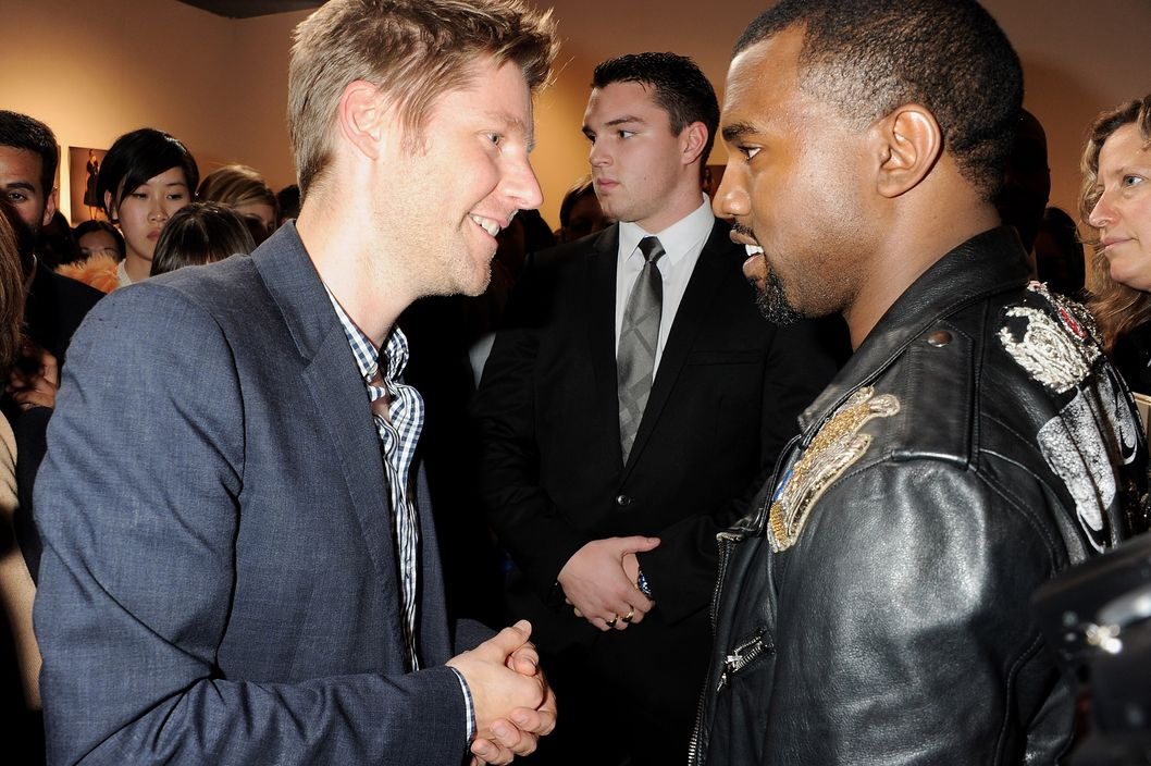 LONDON, ENGLAND - SEPTEMBER 19:  Chief Creative Officer of Burberry Christopher Bailey (L) and Kanye West attend at the Burberry Spring Summer 2012 Womenswear Show at Kensington Gardens on September 19, 2011 in London, England.  (Photo by Dave M. Benett/Getty Images)