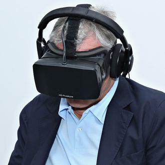 Robert De Niro uses virtual reality goggles on April 22, 2014 in New York City.