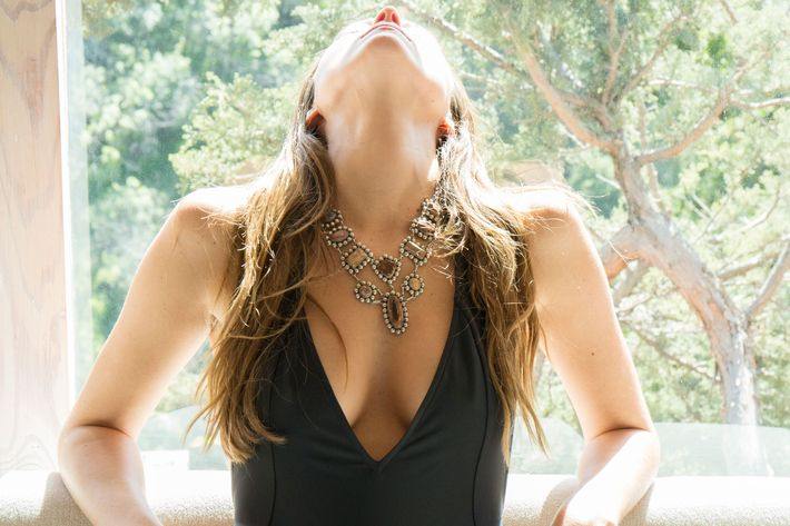 Bodysuit and necklace available on Kindred Black.