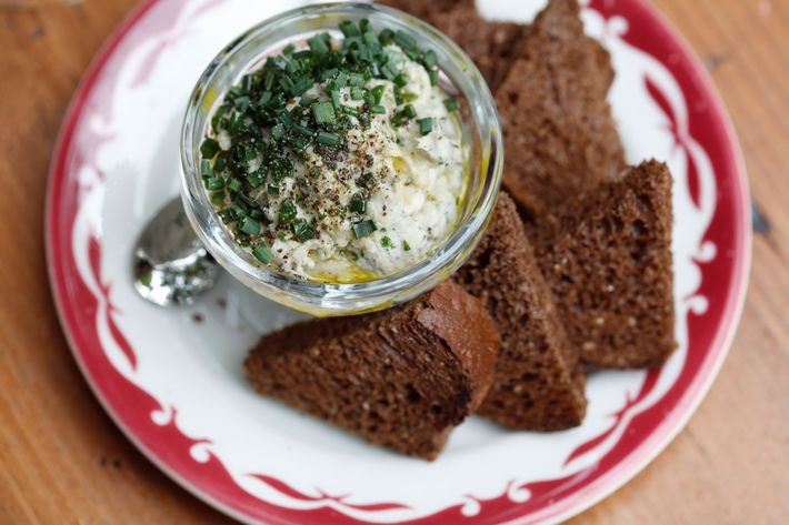 Brown bread with anchovy butter.