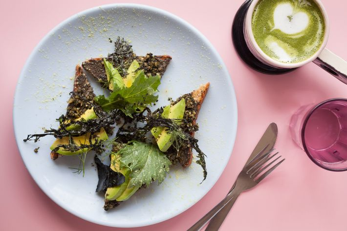 Seaweed pesto-avocado toast, with black bread and walnut-charcoal butter.