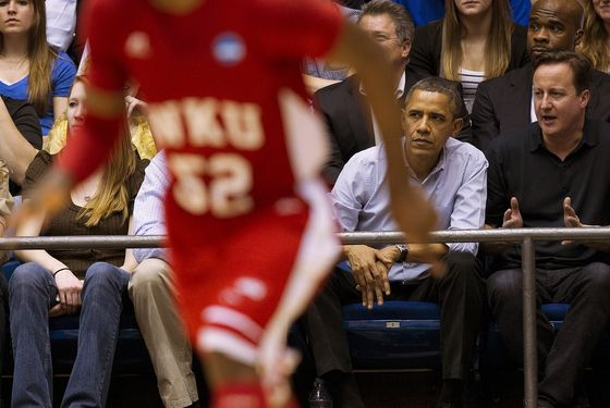 US President Barack Obama (2nd R) and British Prime Minister David Cameron (R) watch Mississippi Valley State University play against Western Kentucky University at the University of Dayton Arena in Dayton, Ohio, March 13, 2012, part of the NCAA Division I Men's Basketball Championship First Four.                AFP PHOTO/Jim Watson (Photo credit should read JIM WATSON/AFP/Getty Images)