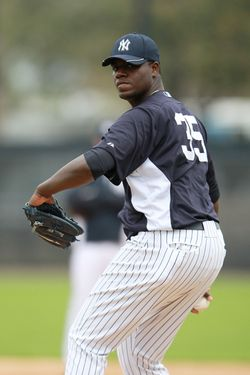 TAMPA, FL - FEBRUARY 26:  Michael Pineda #35 of the New York Yankees warms up prior to the start of the days practice session during the Spring Training workout on February 26, 2012 in Tampa, Florida.  (Photo by Leon Halip/Getty Images)