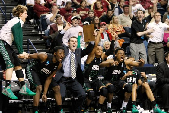 Ohio Bobcats bench reacts to a late three point score as they defeated University of South Florida Bulls to advance to the Sweet 16 during their men's NCAA third round basketball game in Nashville, Tennessee, March 18, 2012. REUTERS/Harrison McClary (UNITED STATES - Tags: SPORT BASKETBALL)