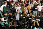 Ohio Bobcats bench reacts to a late three point score as they defeated University of South Florida Bulls to advance to the Sweet 16 during their men's NCAA third round basketball game in Nashville, Tennessee, March 18, 2012.
