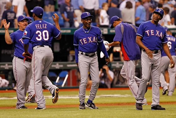 ST. PETERSBURG - OCTOBER 03:  Manager Ron Washington #38 of the Texas Rangers celebrates his team's victory over the Tampa Bay Rays in Game Three of the American League Division Series at Tropicana Field on October 3, 2011 in St. Petersburg, Florida.  (Photo by J. Meric/Getty Images)