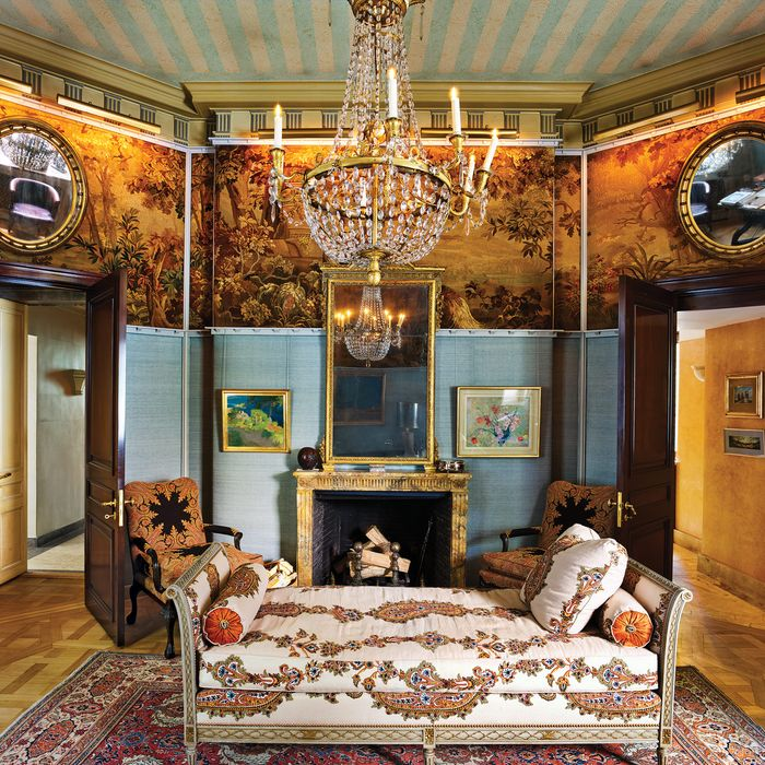 An antique French painted daybed anchors the room.