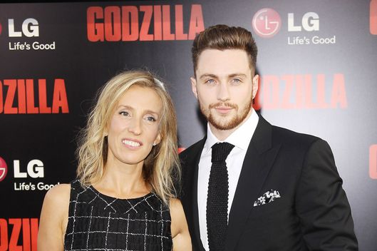"HOLLYWOOD, CA - MAY 08:  Sam Taylor-Wood (L) and Aaron Taylor-Johnson arrive at the Los Angeles premiere of ""Godzilla"" held at Dolby Theatre on May 8, 2014 in Hollywood, California.  (Photo by Michael Tran/FilmMagic)"