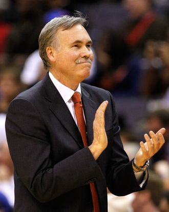 Head coach Mike D'Antoni of the New York Knicks applaudes his team from the sidelines during the second half against the Washington Wizards at Verizon Center on February 8, 2012 in Washington, DC.