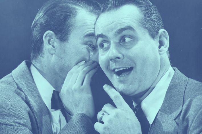 Man whispering to smiling man (B&W)