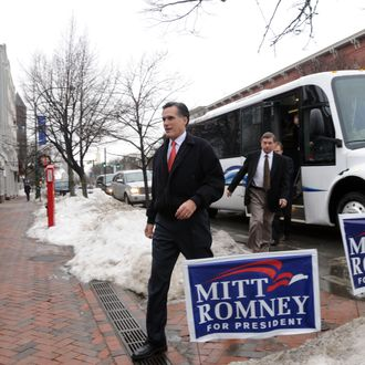 Republican presidential candidate and former Massachusetts Governor Mitt Romney (R) exits his campaign bus along Main Street December 27, 2007 in Nashua, New Hampshire.