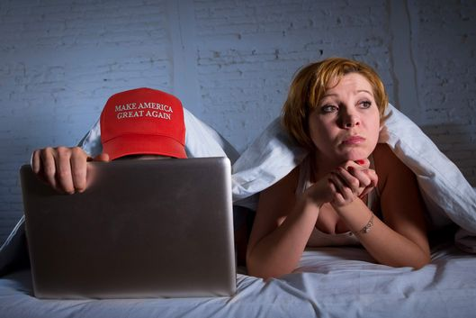 wife upset unsatisfied frustrated in bed husband working on computer