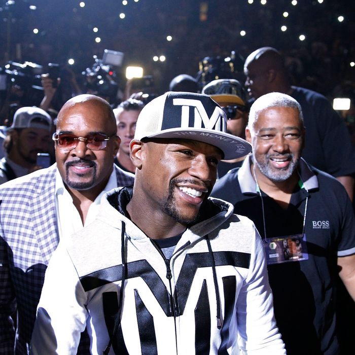 Boxer Floyd Mayweather Jr. walks onto the stage during an arrival ceremony Tuesday, April 28, 2015, in Las Vegas. Mayweather will face Manny Pacquiao in a welterweight boxing match in Las Vegas on May 2. (AP Photo/John Locher)