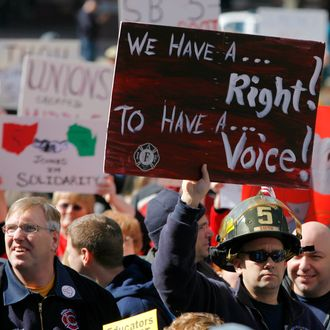 Union supporters make their way into the Ohio Captial building as Gov. John Kasich begins his State of the State address on March 8, 2011 in Columbus, Ohio.