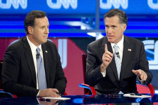 Republican presidential candidates Rick Santorum (L) and Mitt Romney debate on February 22, 2012 in Mesa, Arizona. The Arizona and Michigan primaries are scheduled to be held February 28.     AFP PHOTO/DON EMMERT (Photo credit should read DON EMMERT/AFP/Getty Images)