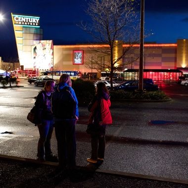People stand in front of Clackamas Town Center mall after a shooting on December 11, 2012 in Clackamas, Oregon. According to reports, two victims and the gunman are dead after emergency dispatchers received reports that a shooting had occurred and a man was seen with an assault rifle near the mall's food court around 3:29 p.m.