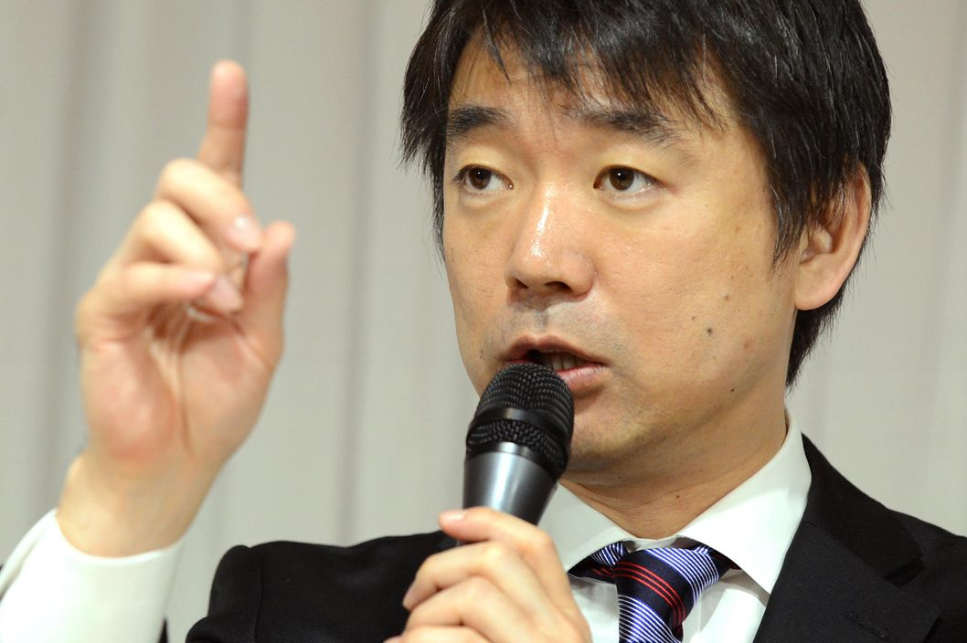 Osaka Mayor and deputy leader of the Japan Restoration Pary (JRP) Toru Hashimoto answers questions during a press conference in Tokyo on November 29, 2012. The Japan Restoration Party announced policy platform ahead of the general election on November 29, 2012.