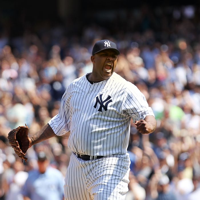 CC Sabathia celebrates pitching a complete game against the Tampa Bay Rays.