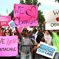 Obamacare supporters react to the  U.S. Supreme Court decision to uphold President Obama's health care law, on June 28, 2012 in Washington, DC. Today the high court upheld the whole healthcare law of the Obama Administration.