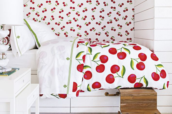 white room with serena & lily duvet cover and stool - strategist best home decor and best duvet cover