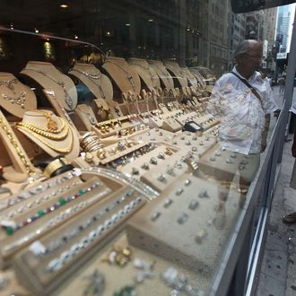 NEW YORK, NY - JULY 18: A man views gold items for sale in the Diamond District of Manhattan on July 18, 2011 in New York City. The price of gold rose above $1600 an ounce today, setting a new all-time record. (Photo by Mario Tama/Getty Images)