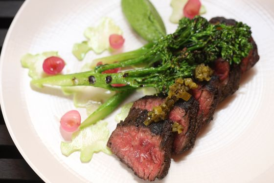 Grass-fed hanger steak with charred broccoli and green sauce.