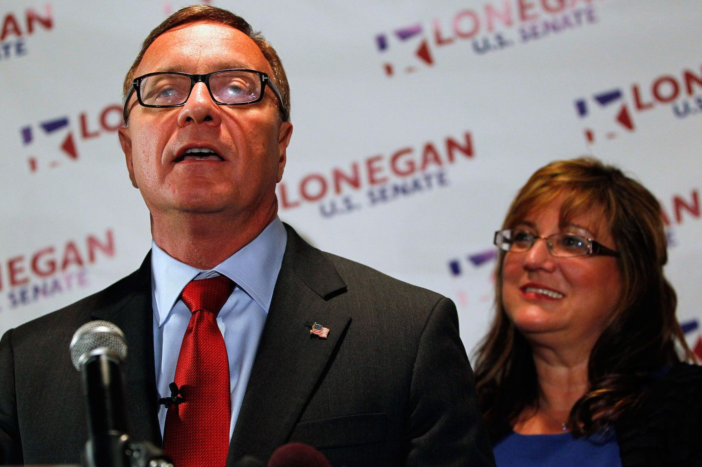 Republican U.S. Senate candidate Steve Lonegan with his wife Lorraine by his side, makes his victory speech after defeating Alieta Eck for the nomination in the special election primary in Secaucus, N.J. Tuesday, Aug. 13, 2013.