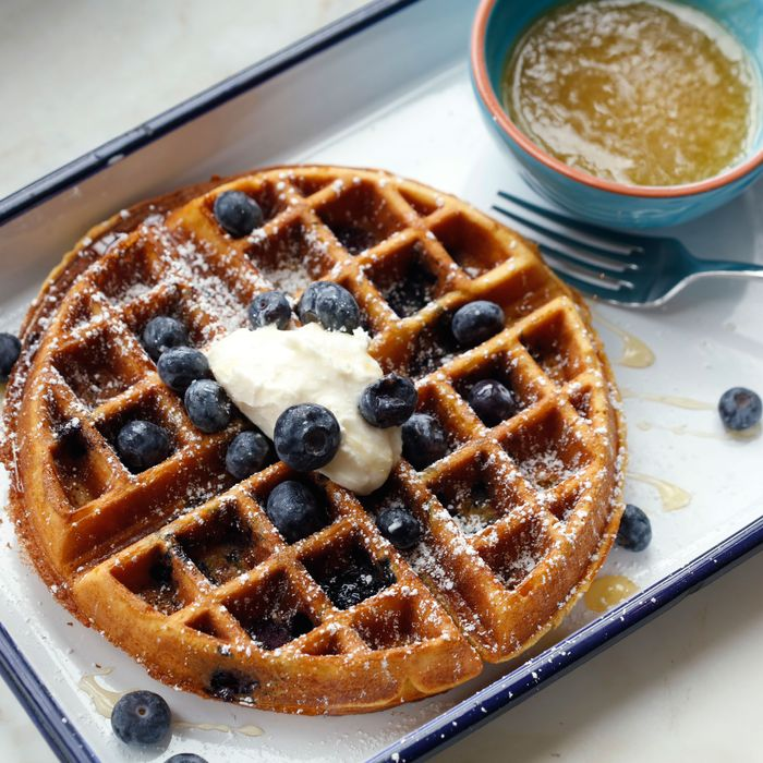 Blueberry-corn waffle with warm honey butter and housemade clabber cream.