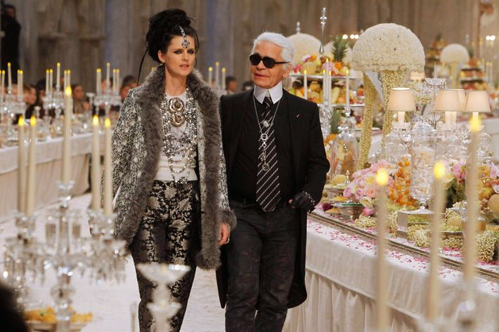 Karl with Stella Tennant on the runway of his pre-fall show.