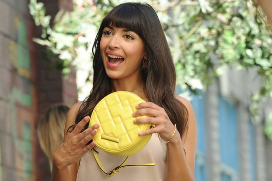 "NEW GIRL:  Cece (Hannah Simone) shows Jess that she purchased a purse they were fighting over in the ""Girl Fight"" episode of NEW GIRL airing Tuesday, Dec. 2 (9:00-9:30 PM ET/PT) on FOX.  ©2014 Fox Broadcasting Co.  Cr: Ray Mickshaw/FOX"