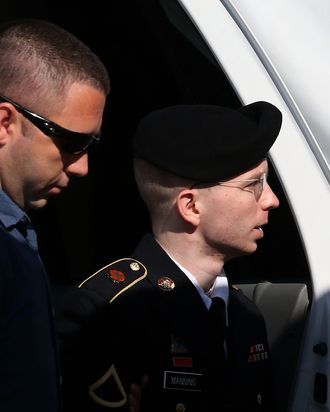 FORT MEADE, MD - JULY 30: U.S. Army Private First Class Bradley Manning (R) is escorted by military police as arrives to hear the verdict in his military trial July 30, 2013 at Fort George G. Meade, Maryland. Manning, who is charged with aiding the enemy and wrongfully causing intelligence to be published on the internet, is accused of sending hundreds of thousands of classified Iraq and Afghanistan war logs and more than 250,000 diplomatic cables to the website WikiLeaks while he was working as an intelligence analyst in Baghdad in 2009 and 2010. (Photo by Mark Wilson/Getty Images)